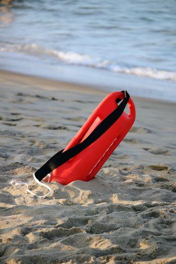 Red umbrella on beach