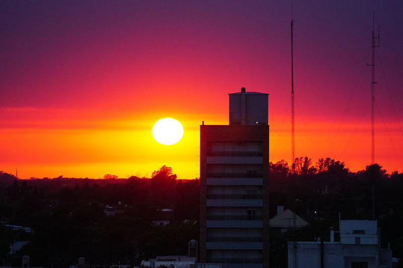 Amanecer en la ciudad. Córdoba Daniel Ramonell Rio Cuarto Architecture Argentina Beauty In Nature Building Exterior Built Structure City Day Nature No People Orange Color Outdoors Silhouette Sky Sun Sunset Tree