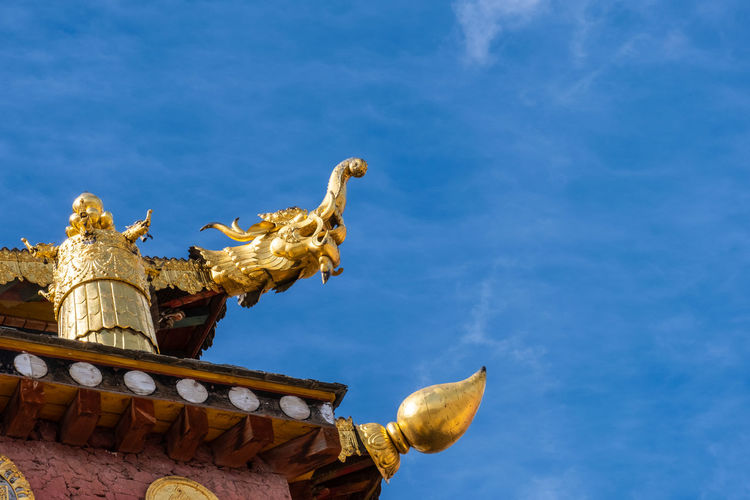Sky Sculpture Representation Statue Art And Craft Architecture Low Angle View Blue Built Structure Creativity No People Belief Craft Spirituality Nature Religion Cloud - Sky Day Human Representation Outdoors Temple Shangrila Shangri-La Yunnan China Tibet Mountain