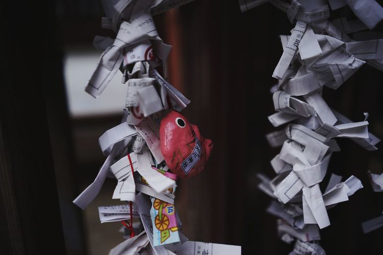 Close-up of stuffed toy hanging on paper