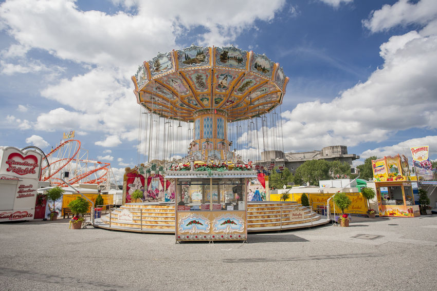 Sommerdom Amusement Park Amusement Ride Carousel Chairoplane Clouds Creativity Culture Cultures Famous Place Fun Ride Hamburg Hamburger Dom Market Market Stall Perspective Sky Tradition Typical