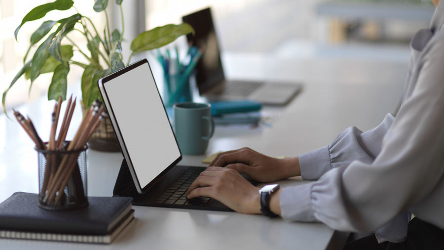 Low angle view of man using laptop on table