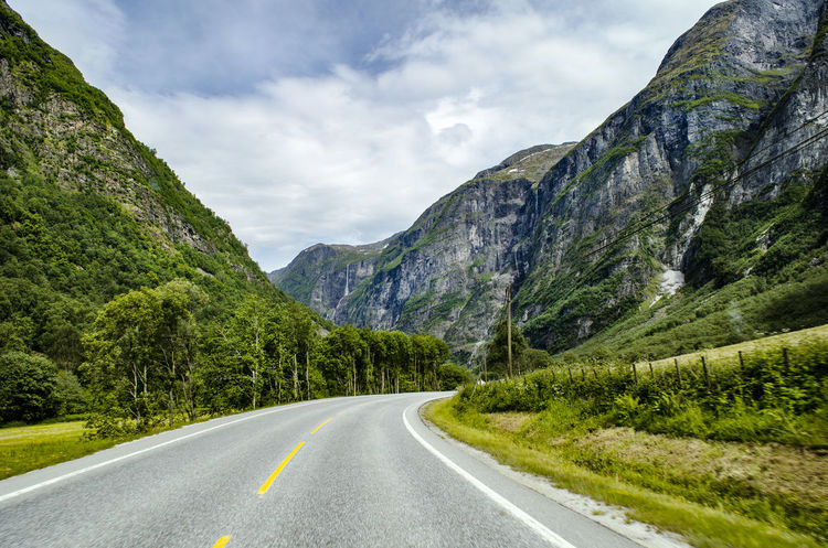 Somewhere in Norway, I don't know :) Nature Norway Norway🇳🇴 Traffic Travel Photography Traveling Activity Asphalt Beauty In Nature Cloud - Sky Day Dividing Line Dynamic Green Color Landscape Mountain Mountain Road Nature No People Norway Nature Outdoors Road Scenics Sky Speed The Way Forward Tranquil Scene Tranquility Transportation Travel Destinations Tree White Line Winding Road
