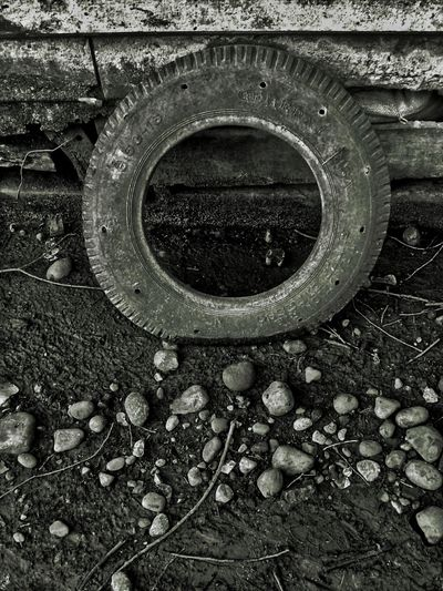 abandoned Wheel Black & White Abandoned Blackandwhite Close-up Damaged Deterioration Dirty Gravel Grunge Land Vehicle Lenk Metal Mode Of Transportation No People Obsolete Old Outdoors Pollution Run-down Solid Tire Track Transportation Tyre Wheel