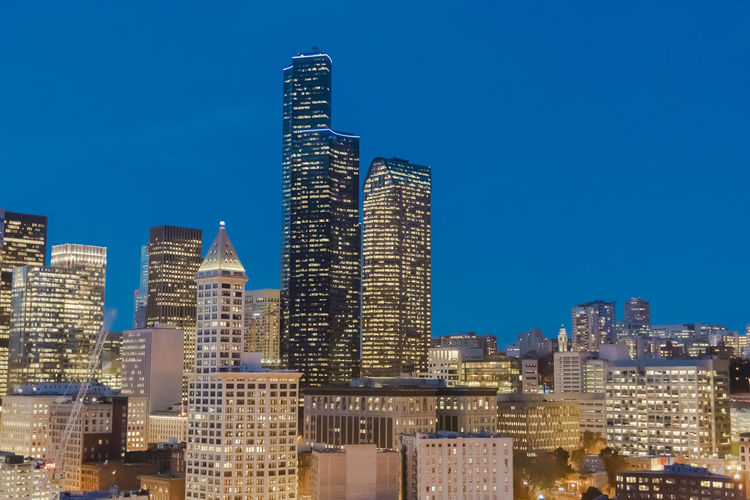 Aerial view of downtown Seattle Washington at dusk. Bird Eye View Aerial Architecture Blue Building Exterior Built Structure City Cityscape Dawn Dusk Flying Glowing Homeless Population Housing Crisis Illuminated No People Outdoors Real Estate Sea Sky Travel Destinations