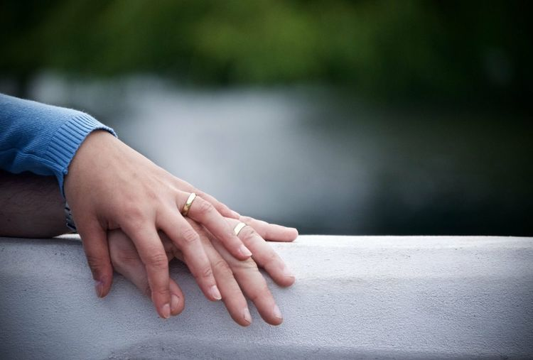 Close-up of woman hand holding hands