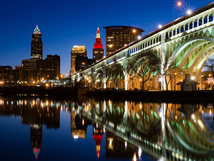 Clear Sky Cleveland Cuyahoga River Arch Arch Bridge Architecture Building Building Exterior Built Structure City City Life Clean Cleveland Ohio Illuminated Night No People Office Building Exterior Reflection Sky Skyscraper Tower Travel Travel Destinations Water Waterfront