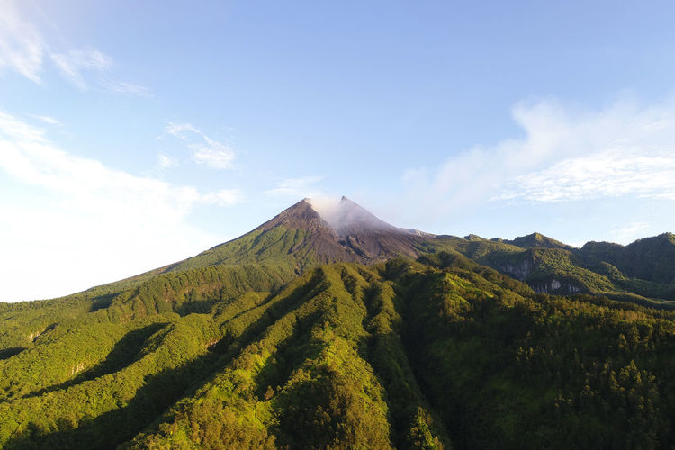 Beautiful Mount Merapi in the morning Holiday INDONESIA Merapi Volcano Mountain View My Best Travel Photo Travel Yogyakarta Beauty In Nature Environment Eruption Green Color Land Landscape Merapi Yogyakarta Mountain Mountain Peak Mountains Nature Outdoors Plant Scenics - Nature Sky Travel Destinations Volcanic Crater Volcano