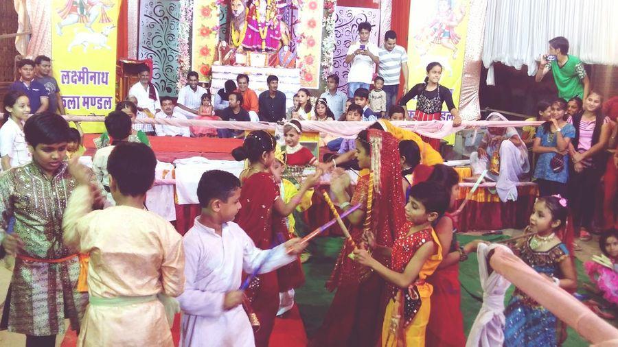 The Culture Of The Holidays Navratri Festival Dandiya Dance Children Babygirl Babyboy Casual Clothing Night Hinduism Lord Durga City Life Fatehpur Rajasthan Person Men Rear View Building Exterior City City Life Casual Clothing Outdoors Retail