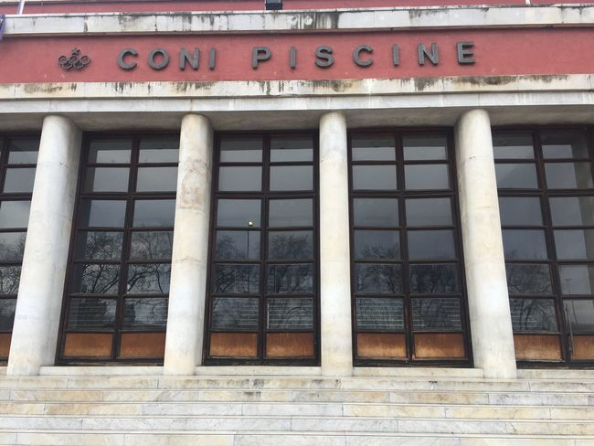 Rome, Italy - January 7, 2017: Coni swimming center exterior at Foro Italico. Coni is the Italian National Olympic Committee Fascism Architecture Rome Architecture Building Exterior Built Structure Coni Fascistarchitecture Foro Italico Italian No People Olympic Committee Outdoors Swimming Pool Villaggioolimpico