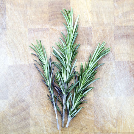 Sprigs of Rosemary on wooden chopping board Background Chopping Board Close Up Close-up Detail Flavouring Food Photography Freshness Green Green Color Herb Herbs High Angle View Ingredient Leaf Plant Rosemary Sprig Sprigs Wooden