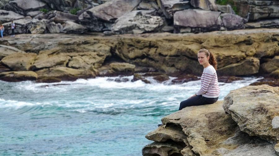 I could spend my entire day watching the waves crashing into the rocks.. Candid Tranquility Travel EyeEm Best Shots EyeEm Gallery EyeEm Nature Lover Happiness Australia Sydney Blue Travel Destinations Sunny Rock - Object Girl Woman EyeEm Selects Water Sea Women Standing Sitting Rock - Object Shore Wave Crashing Tide Surf Horizon Over Water Calm Rock Formation