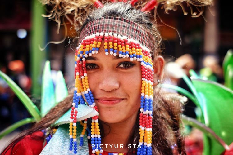 """Mestiza"" A portrait of a student during the Kadayawan sa Davao Festival, She is participating the Indak-Indak sa Kadalanan event and celebration. Fujifilm XT100 7artisans Randomphotos Composition Philippines Hobbyistphotographer Ndfiltered Photographer Landscapephotography Fuji Lensculture Newbie Streetphotographyworldwide Street_focus_on Streets_storytelling Streetphotography Streetsleaks Streetclassics Streetphotographycommunit Young Women Portrait Beautiful Woman Multi Colored Holi Beauty Smiling Happiness Beautiful People Headshot"
