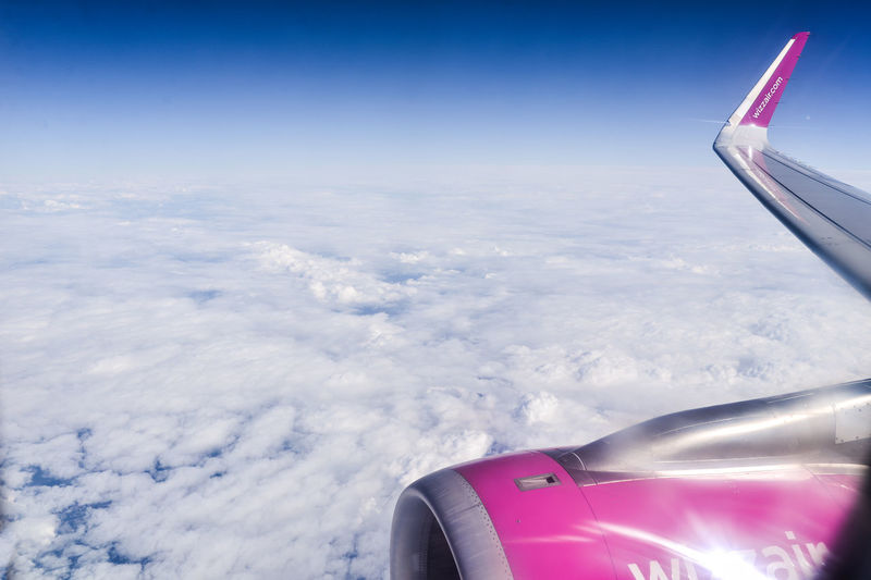 Aerial view of airplane flying in sky