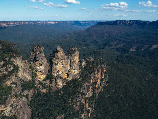 The Three Sisters Australia Three Sisters Blue Mountains Mountain Scenics - Nature Environment Beauty In Nature Tranquil Scene Landscape Tranquility Mountain Range Nature Sky Rock Rock Formation High Angle View No People Physical Geography Outdoors Geology Rock - Object Formation Day Idyllic New South Wales