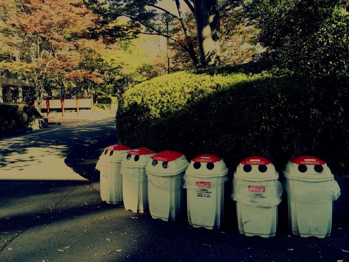 Trashcan Robots Stand In Line