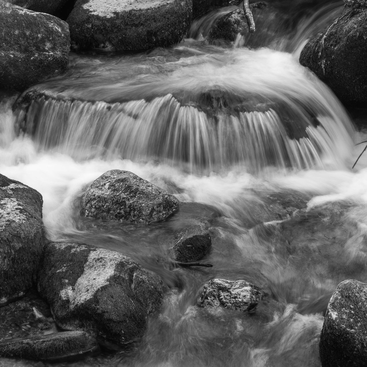 long exposure, rock, motion, scenics - nature, rock - object, solid, beauty in nature, blurred motion, water, flowing water, waterfall, no people, flowing, nature, day, outdoors, travel destinations, environment, land, stream - flowing water, falling water, power in nature