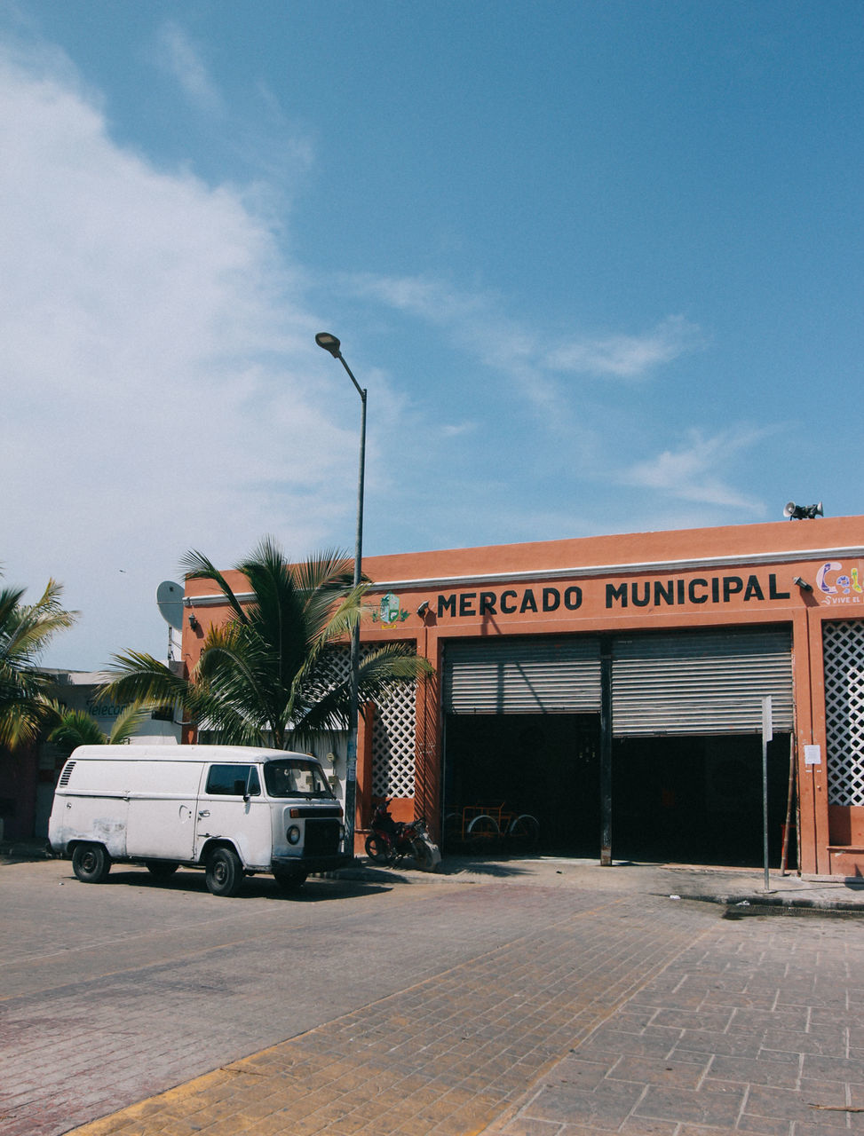 CARS ON ROAD AGAINST BUILDINGS
