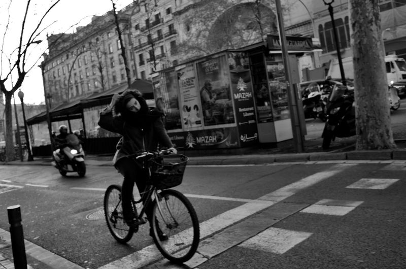 Transportation Mode Of Transportation Land Vehicle Architecture Building Exterior City Bicycle Street Built Structure Riding Ride Real People Road on the move Full Length Day Incidental People Lifestyles People Motion Outdoors Barcelona