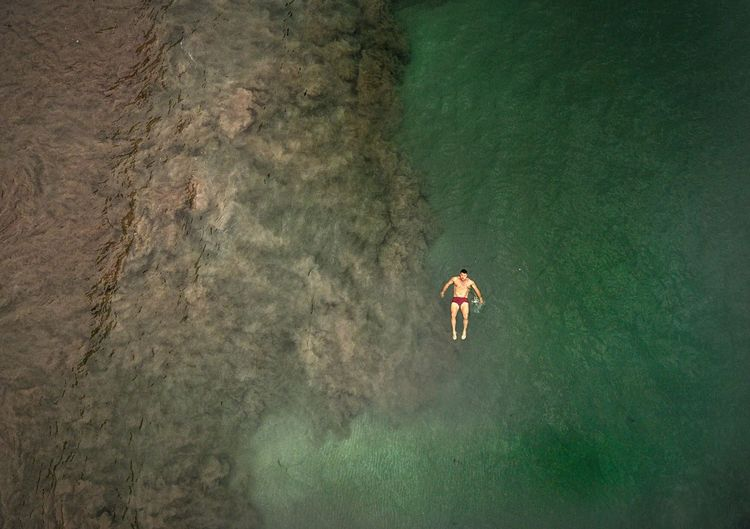 Aerial View Of Mid Adult Man Swimming In Sea