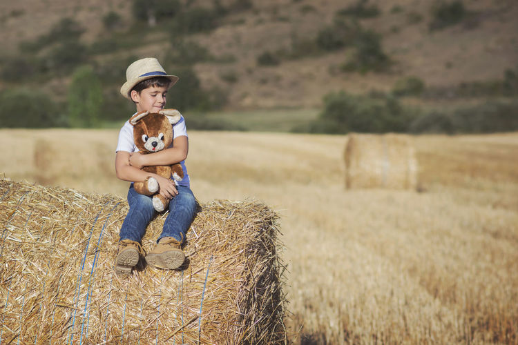 Freedom Fun Funny Happiness Happy Holidays Love Agriculture Bale  Child Childhood Farm Field Friendship Happiness Hay Nature Playful Portrait Rural Scene Sitting Smile Smiling Straw Teddy Bear
