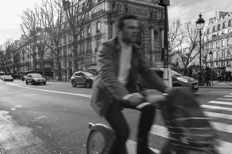 Oh, pardon! Architecture Bicycle Black And White Blackandwhite Blurred Motion Building Exterior Built Structure Car City City Life Cycling Day Land Vehicle Lifestyles Mode Of Transport Motion One Person Outdoors Paris Real People Riding Road Speed Street Transportation