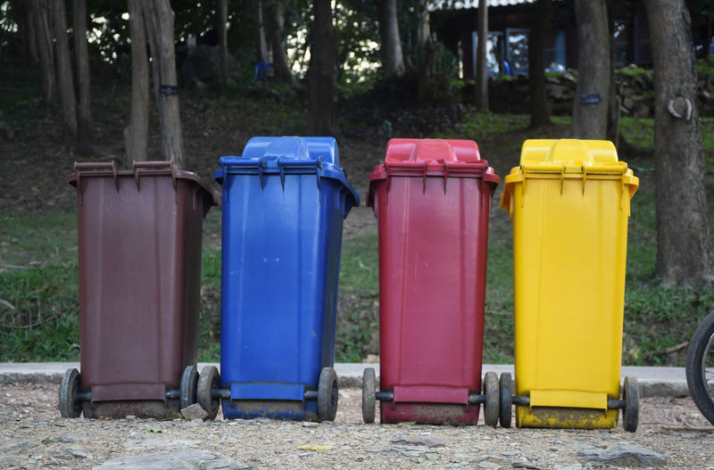 type wheelie trash can, garbage can, dustbin, rubbish bin row in public park Disposal Dustbin Ecology Environment Garbage Grassygreen Metal Plastic Recycle Recycling Rubbish Street , Paper , Refuse Box Container Green Trash Bin Can Clean Outdoors Paper Park Waste