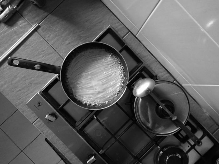 High Angle View Of Food Boiling In Saucepan On Stove