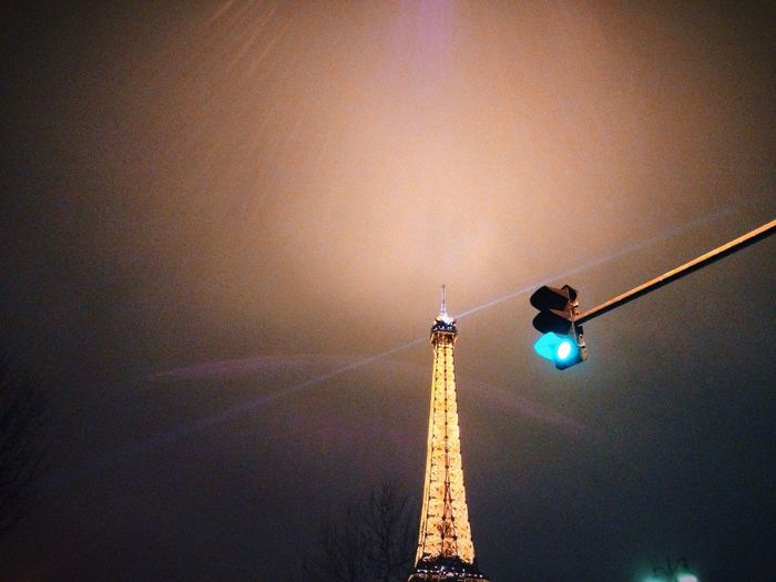 Low angle view of illuminated tower against sky
