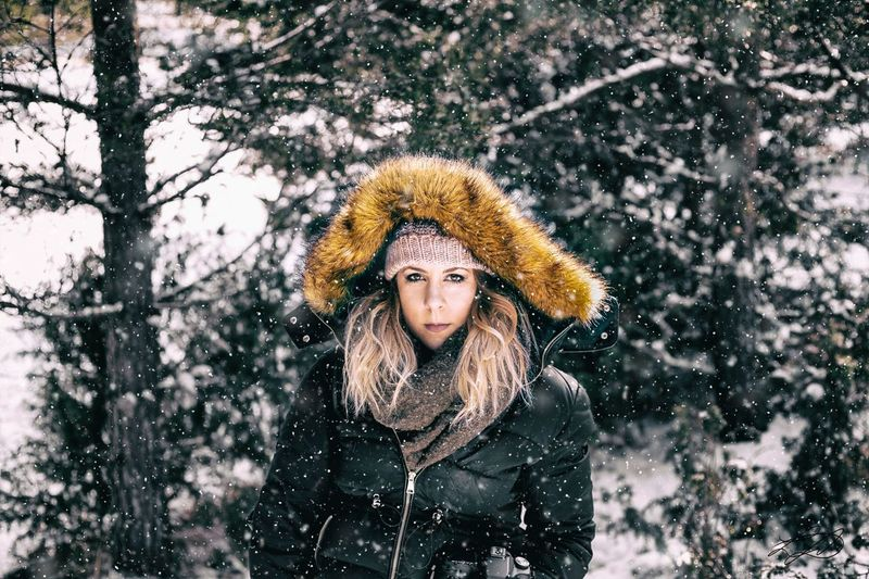 Portrait Of Woman In Warm Clothing During Snowfall