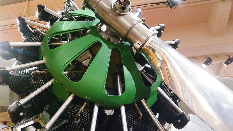 Green Machine Propeller Plane Green Color Silver  Blade Shiny Green Color High Angle View Indoors  Close-up