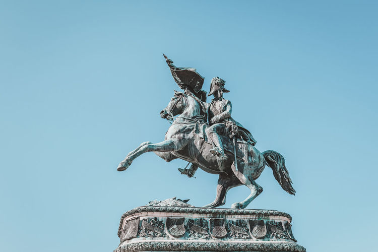 Equestrian statue of Archduke Karl in Vienna Archduke Karl Equestrian Statue Vienna Angel Architecture Art And Craft Blue Clear Sky Copy Space Creativity Day Horse Human Representation Livestock Low Angle View Male Likeness Nature No People Outdoors Representation Sculpture Sky Statue