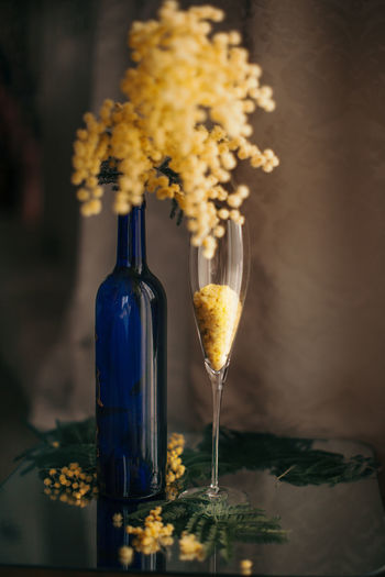Close-up of wine glass bottle on table