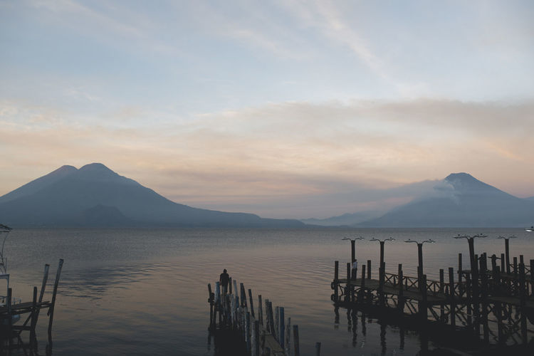 Beauty In Nature Cloud - Sky Idyllic Land Mountain Mountain Peak Mountain Range Nature No People Non-urban Scene Outdoors Reflection Scenics - Nature Sea Sky Sunset Tranquil Scene Tranquility Volcano Water Wooden Post