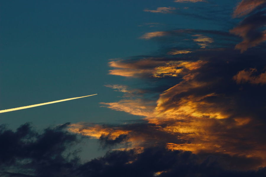 the plane flies through thunderclouds. Cloudscape Colors Dark Dramatic Sky Telegram Air Vehicle Airplane Background Beauty In Nature Cloud - Sky Clouds Danger Dusk Meteorology Nature No People Orange Color Scenics - Nature Sky Sunset Swallow Thunder Clouds Thunderstorm Vapor Trail EyeEmNewHere