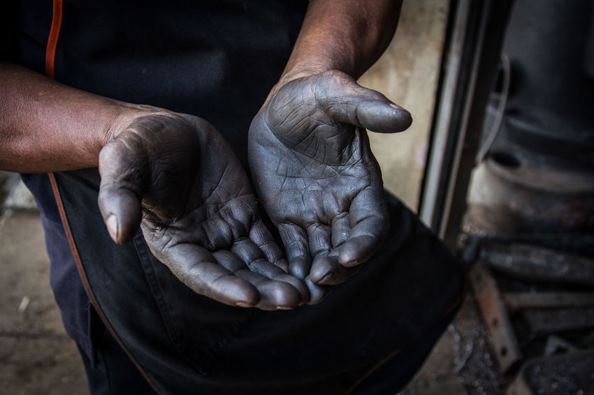 Black Color Body Part Close-up Day Dirt Dirty Finger Focus On Foreground Hand High Angle View Human Body Part Human Finger Human Hand Human Limb Mechanic Men Occupation One Person Real People Working