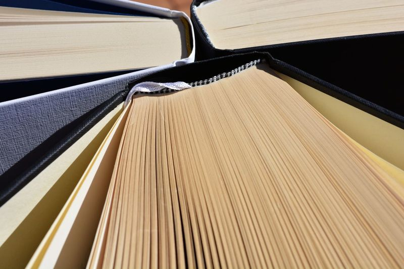 Hardback books, Research Library Full Frame Paper Pattern Pages Of A Book Wisdom Scholarship Learning Education Hardback Books No People Close-up Indoors  Day