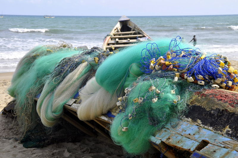 Fishing Net On Boat Moored At Beach
