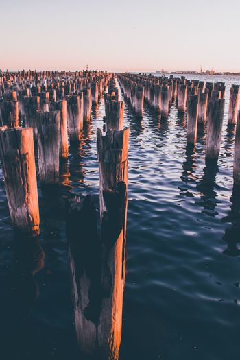 Beautiful sunset panoramic view of the historic princes pier in melbourne