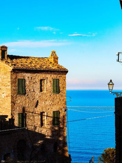 Home Home Water Sea Beach Blue Clear Sky History Sky Architecture Horizon Over Water Building Exterior Seascape
