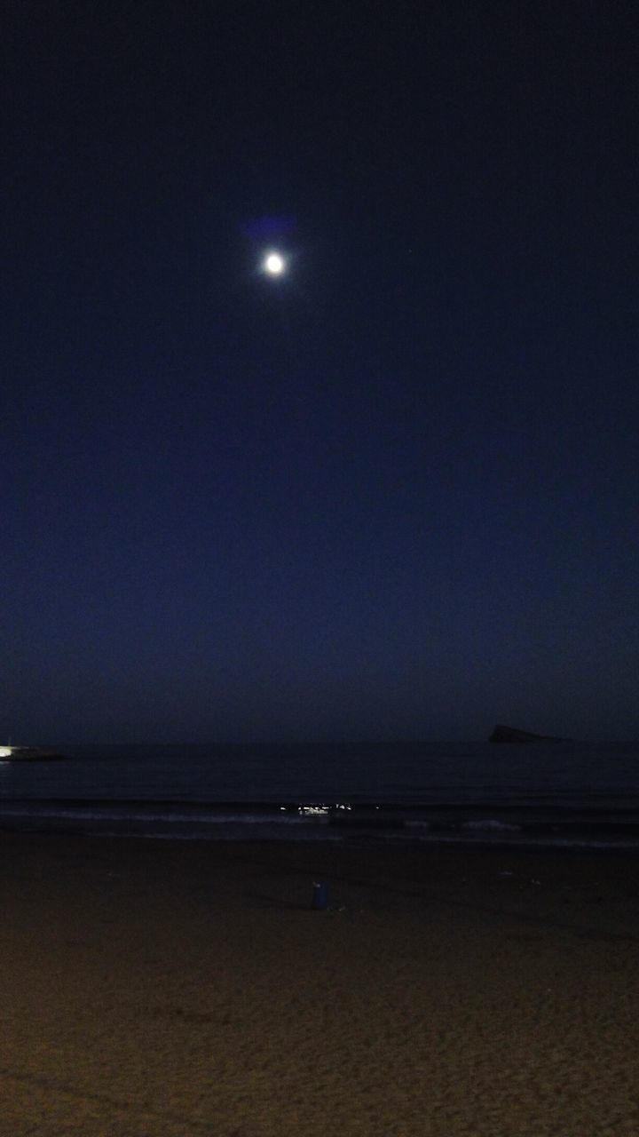 moon, sea, beach, night, nature, horizon over water, tranquil scene, scenics, tranquility, sand, sky, beauty in nature, water, moonlight, outdoors, clear sky, illuminated, no people, astronomy