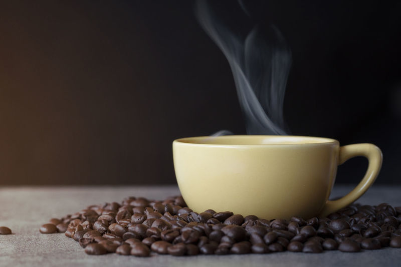 Cup of coffee with coffee bean on black background Coffee Food And Drink Coffee - Drink Cup Mug Drink Roasted Coffee Bean Coffee Cup Steam Food Close-up No People Heat - Temperature Refreshment Indoors  Freshness Hot Drink Copy Space Table Still Life Black Background Caffeine Crockery Non-alcoholic Beverage Tea Cup