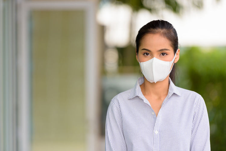 Portrait of a young woman wearing face mask