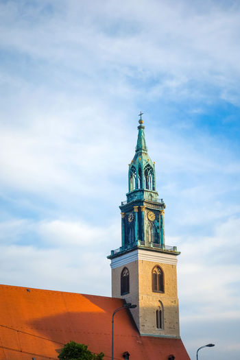 Low Angle View Of St Mary Church Against Cloudy Sky