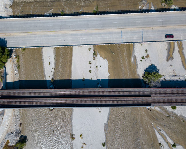 High angle view of railroad tracks by wall