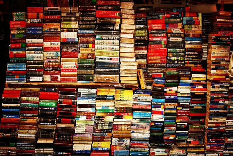 A Sea of Books Urbex Street Streetphotography Books Multi Colored Backgrounds Full Frame Choice Store Retail  Variation Collection For Sale Close-up Colorful Variety Shelf Retail Display Window Display Market Stall Shop Bookshelf Shelves