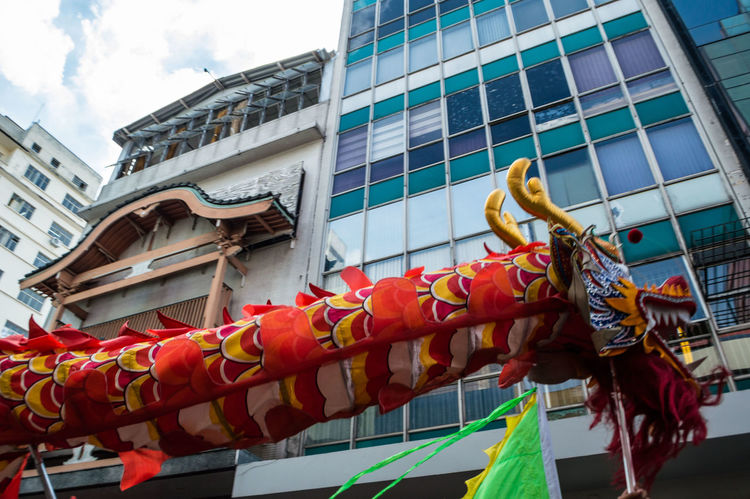 Chinese New Year Chinese Culture Dragon EyeEm Selects Architecture Building Exterior Cultures Celebration Traditional Festival Tradition Outdoors Built Structure Adults Only Adults Only Travel Destinations Day Sky People City Dragon Adult