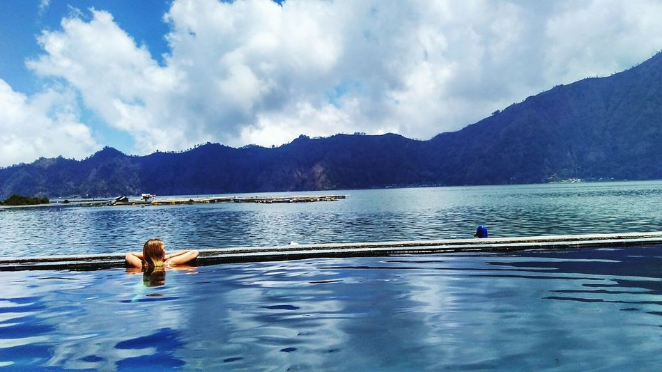 Chillin' at natural hot spring Relaxing Enjoying Life Temantravel Adventure Buddies Islandlife Explorebali Trip Travel Landscape #Nature #photography HEAVENONEARTH First Eyeem Photo Chilling Naturalhotsprings Infinitypool Lakeview Kintamani Bali, Indonesia