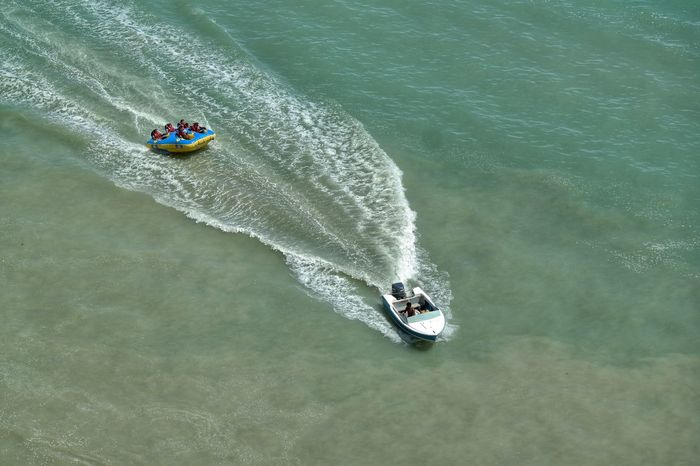 Adventure Club Tubing Tubing Time Tubing Inflatable  Inflatables Speedboat Wake Exhilirating Splashing Waves Sea Sea Sports Bouncing On Waves Rubber Dinghy Rubberfu Water Splash Water Sports Towing The Dinghy Towing Fun Happiness Fun On The Water Boats A Bird's Eye View