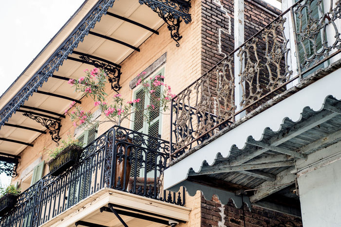 Architecture new orleans Building Exterior Equipment Southern Iron Fence New Orleans Life Ferns Foliage Balcony Travel Destinations Historic Katrina New Orleans Architecture Pink Peach Louisiana